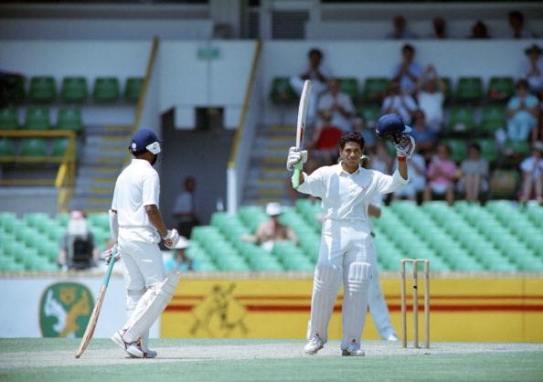 Indian batsman Sachin Tendulkar raises h