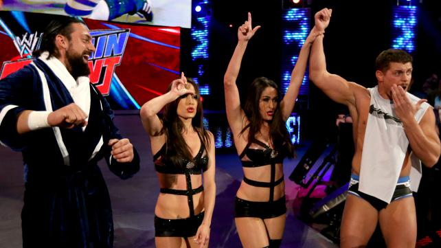 The Bellas celebrating their victory over the funkadactyls with Cody Rhodes and Damien Sandow