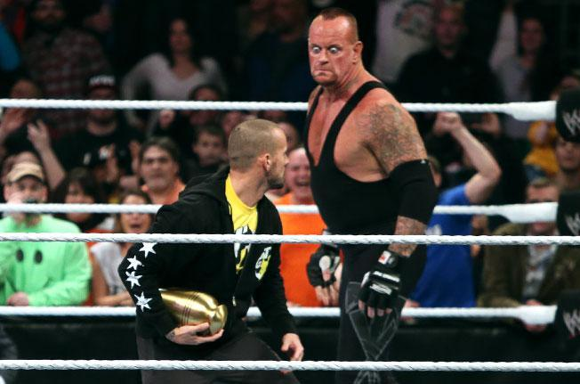 Undertaker gets set to attack CM Punk on RAW