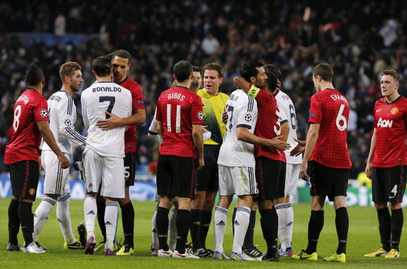 Real Madrid's players and Manchester United's players acknowledge each other at the end of the UEFA Champions League round of 16 first leg football match Real Madrid CF vs Manchester United FC at the Santiago Bernabeu stadium in Madrid on February 13, 2013. The match ended in a 1-1 draw.