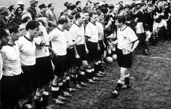 World Cup Final, 1954, Berne, Switzerland, 4th July, 1954, West Germany 3 v Hungary 2, West German captain Fritz Walter shows off the World Cup trophy to his teammates after their win