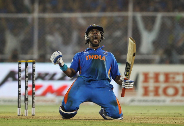 Yuvraj Singh of India celebrates hitting the winning runs during the 2011 ICC World Cup Quarter Final match between Australia and India at Sardar Patel Stadium on March 24, 2011 in Ahmedabad, India.  (Photo by Matthew Lewis/Getty Images)