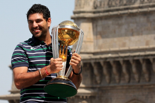 Yuvraj Singh of the Indian cricket team poses with the  ICC Cricket World Cup Trophy, with the Gateway of India in the backdrop, during a photo call at the Taj Palace Hotel on April 3, 2011 in Mumbai, India.  (Photo by Ritam Banerjee/Getty Images)