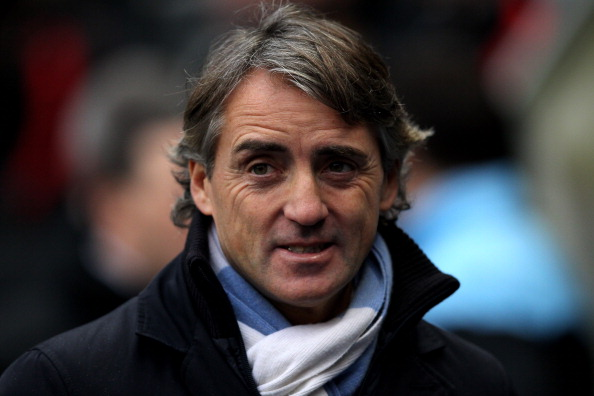 MANCHESTER, ENGLAND - JANUARY 08:  Manchester City Manager Roberto Mancini looks on prior to the FA Cup Third Round match between Manchester City and Manchester United at the Etihad Stadium on January 8, 2012 in Manchester, England. (Photo by Alex Livesey/Getty Images)