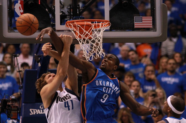 Serge Ibaka #9 of the Oklahoma City Thunder blocks the shot attempt by Dirk Nowitzki #41 of the Dallas Mavericks during Game Four of the Western Conference Quarterfinals in the 2012 NBA Playoffs at American Airlines Center on May 5, 2012 in Dallas, Texas. NOTE TO USER: User expressly acknowledges and agrees that, by downloading and or using this photograph, User is consenting to the terms and conditions of the Getty Images License Agreement.  (Photo by Ronald Martinez/Getty Images)