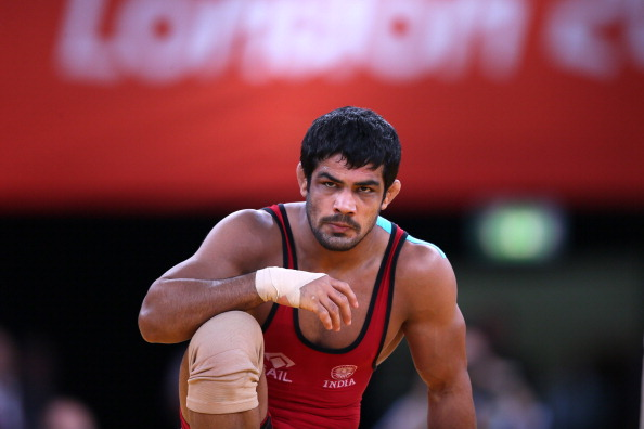 India's  Sushil Kumar reacts during his fight against Japan's  Tatsuhiro Yonemitsu in their Men's 66kg Freestyle gold medal match on August 12, 2012 during the wrestling event of the London 2012 Olympic Games.  AFP PHOTO / MARWAN NAAMANI        (Photo credit should read MARWAN NAAMANI/AFP/GettyImages)