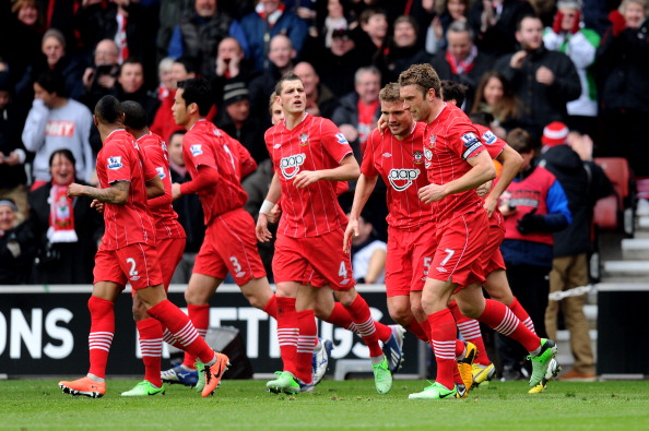 Rickie Lambert (RL) of Southampton celebrates with teammates after scoring his team's second goal with a free kick during the Barclays Premier League match between Southampton and Chelsea at St Mary's Stadium on March 30, 2013 in Southampton, England.  (Photo by Mike Hewitt/Getty Images)