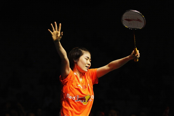 Deng Xuan of China celebrates winning the New Zealand Badminton Open Women's Singles final match between Yamaguchi Akane of Japan and Deng Xuan of China at North Shore Events Centre on April 14, 2013 in Auckland, New Zealand.  (Photo by Hannah Johnston/Getty Images)