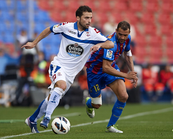 Juanfran (R) of Levante competes for the ball with Bruno Gama of Deportivo de La Coruna during  the la Liga match between Levante UD and RC Deportivo de La Coru?a at Ciutat de Valencia on April 13, 2013 in Valencia, Spain.  (Photo by Manuel Queimadelos Alonso/Getty Images)