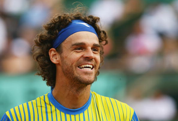 PARIS - MAY 25:  Gustavo Kuerten of Brazil smiles at the fans after his career ending defeat during Men