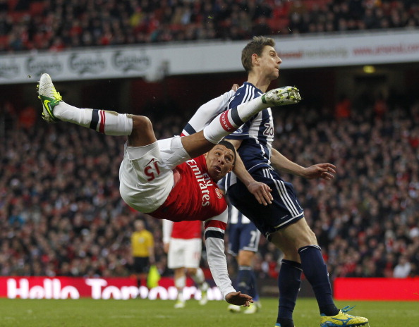 Arsenal's English striker Alex Oxlade-Chamberlain takes a shot at goal during the English Premier League football match between Arsenal and West Bromwich Albion at the Emirates Stadium in north London on December 8, 2012.