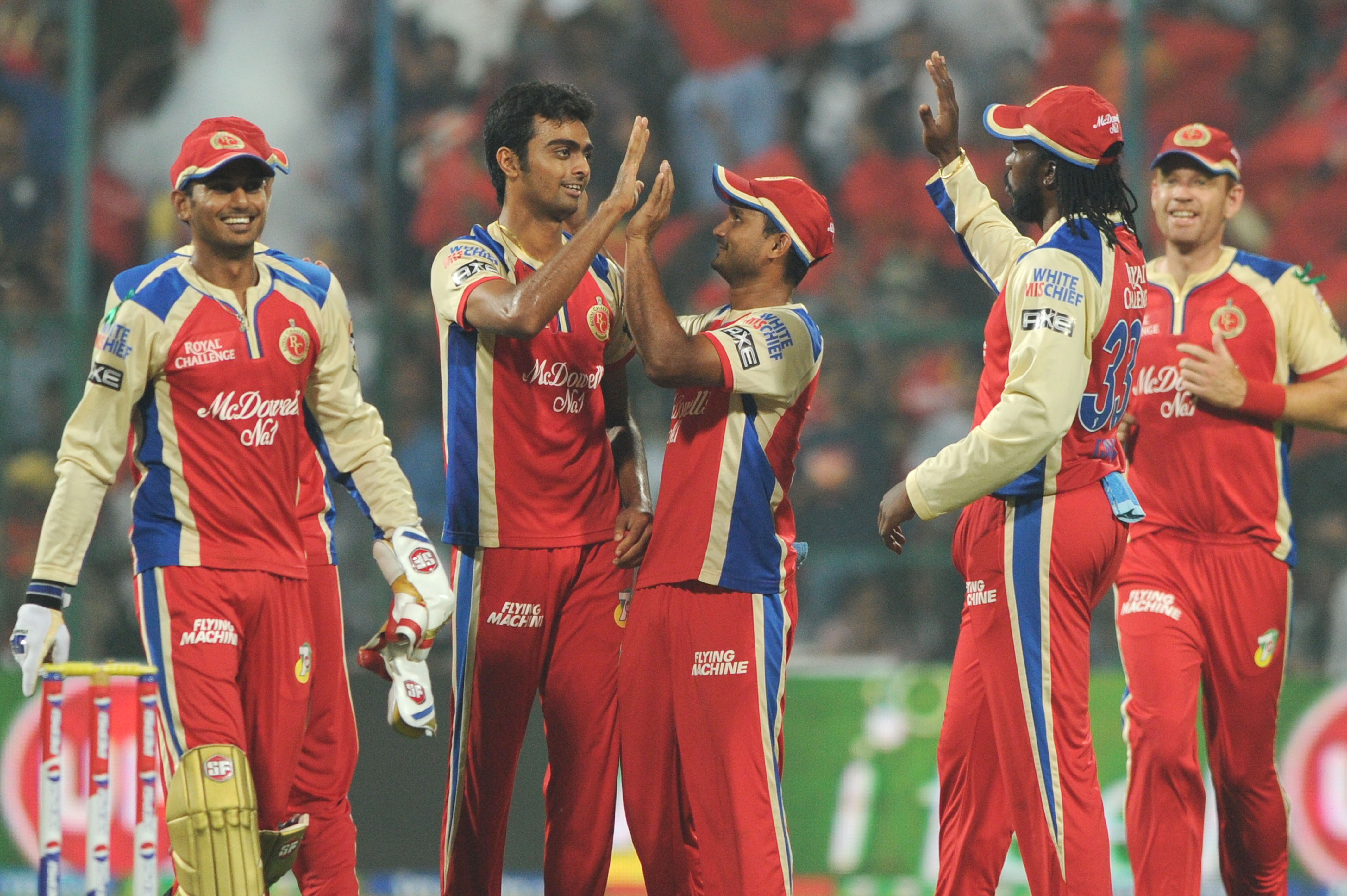 RCB players celebrate fall of wicket during the match between Delhi Daredevils and Royal Challengers Bangalore at M Chinnaswamy Stadium, Bangalore on April 16, 2013. (Photo: IANS)