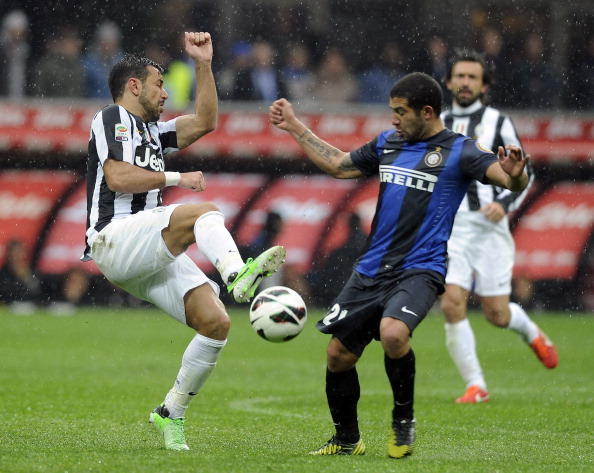 MILAN, ITALY - MARCH 30:  Fabio Quagliarella of Juventus FC (L) and Walter Gargano of FC Inter Milan compete for the ball during the Serie A match between FC Internazionale Milano and Juventus FC at San Siro Stadium