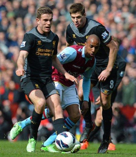 Aston Villa's Fabian Delph (centre) vies with Liverpool's Steven Gerrard (right) and Jordan Henderson (left) on March 31