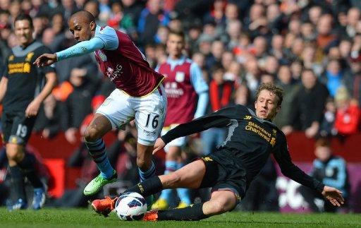 Aston Villa'sFabian Delph (left) vies with Liverpool's Lucas Leiva at Villa Park in Birmingham on March 31, 2013