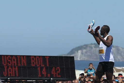 Usain Bolt takes off his running shoes in Rio de Janeiro, Brazil, on March 31, 2013