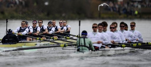 The Oxford University boat crew (L) pull ahead during the annual boat race on the River Thames in London, March 31, 2013