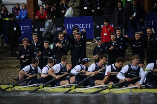 The Oxford University boat crew celebrate after beating Cambridge during the annual boat race, London, March 31, 2013