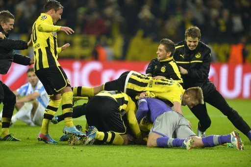 Dortmund's players celebrate in Dortmund, western Germany on April 9, 2013