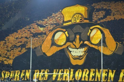 Dortmund's fans wave yellow colours behind a giant poster on April 9, 2013