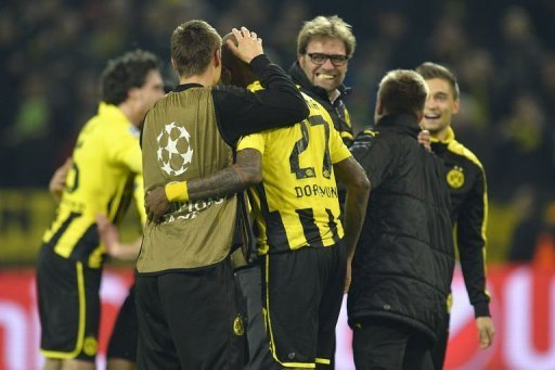 Dortmund's head coach Juergen Klopp celebrates with Felipe Santana (C) who scored the winning goal on April 9, 2013