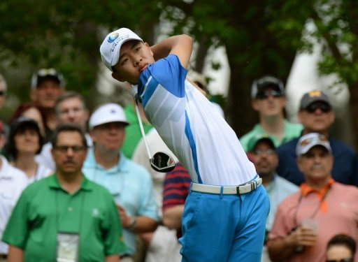 Guan Tianlang hits a shot during the first round of the 77th Masters on April 11, 2013 in Augusta