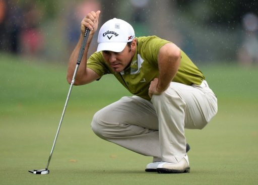 Trevor Immelman of South Africa plays in the rain during the second round of the 77th Masters, April 12, 2013 in Augusta