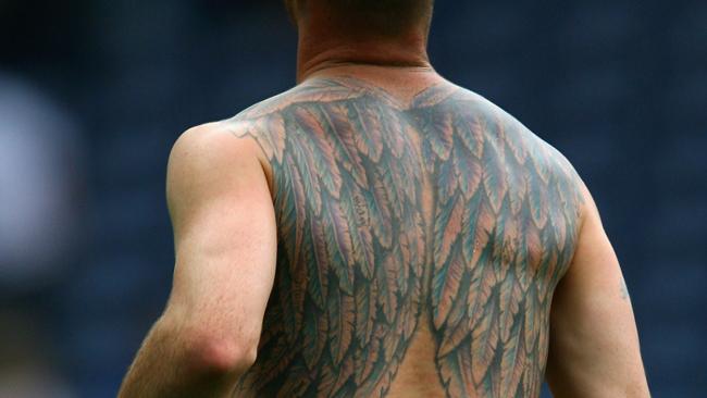 #11 football team of tattooed players