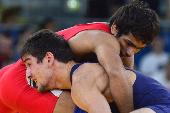 India's  Amit Kumar (R) wrestles Georgia