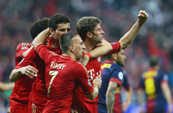 Thomas Mueller of Bayern Muenchen celebrates scoring the opening goal with Franck Ribery during the UEFA Champions League Semi Final First Leg match between FC Bayern Muenchen and Barcelona at Allianz Arena on April 23, 2013 in Munich, Germany.  (Photo by Christof Koepsel/Bongarts/Getty Images)