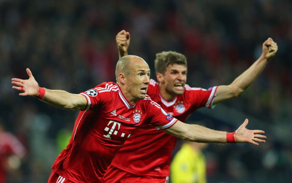 rjen Robben of Bayern Muenchen celebrates with team-mate Thomas Mueller after scoring a goal during the UEFA Champions League final match between Borussia Dortmund and FC Bayern Muenchen at Wembley Stadium on May 25, 2013 in London, United Kingdom.  (Photo by Alex Livesey/Getty Images)