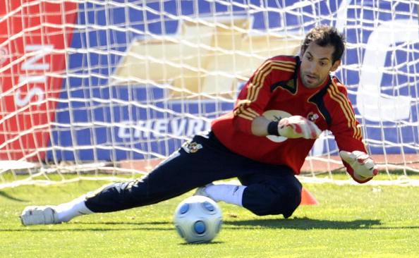 Spanish goalkeeper Diego Lopez stops a b