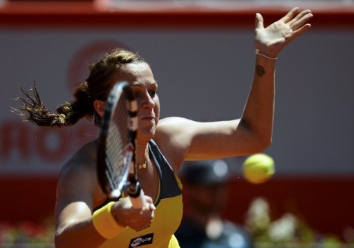 Anastasia Pavlyuchenkova returns the ball to Romina Oprandi during the Portugal Open in Oeiras on May 3, 2013