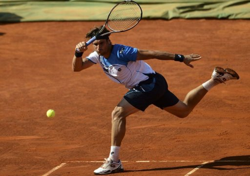Spanish player David Ferrer returns the ball to Romanian player Victor Hanescu in Oeiras on May 3, 2013