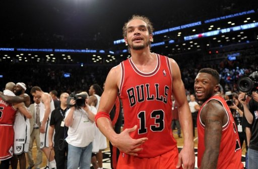 Joakim Noah (C) and Nate Robinson (R) of the Chicago Bulls celebrate their 99-93 win over the Brooklyn Nets, May 4, 2013