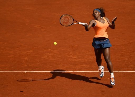 Serena Williams returns the ball to Anabel Medina during their match at the Madrid Masters in Madrid on May 10, 2013