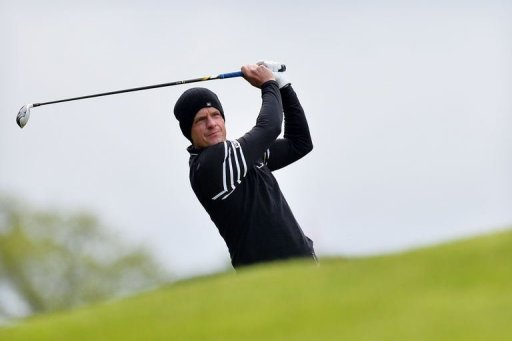 English golfer Luke Donald plays his approach shot to the 1st green in Surrey, England, on May 24, 2013
