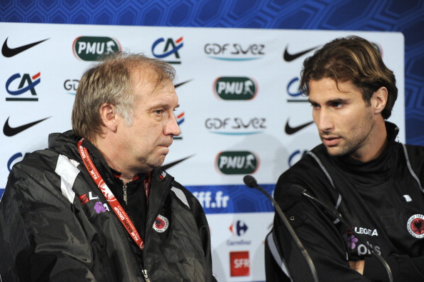 Albania's national football team coach Josip Kuze (L) speaks with his player Lorik Cana during a press conference on October 6, 2011, at the Stade de France in Saint-Denis, near Paris, on the eve of the Euro2012 qualifier match France vs. Albania. AFP PHOTO / BERTRAND GUAY AFP PHOTO / BERTRAND GUAY (Photo credit should read BERTRAND GUAY/AFP/Getty Images)