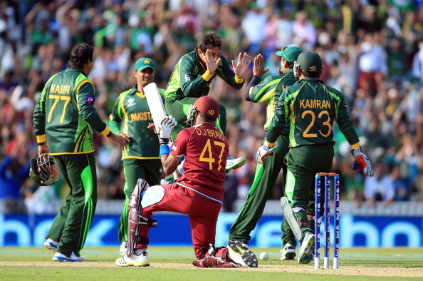 Saeed Ajmal of Pakistan celebrates taking the wicket of Dwyane Bravo of West Indies during the ICC Champions Trophy group B match between West Indies and Pakistan at The Oval on June 7, 2013 in London, England.  (Photo by Richard Heathcote/Getty Images)