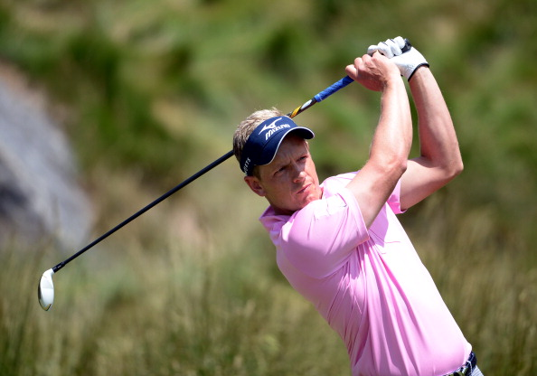 Luke Donald of England hits his tee shot on the 18th hole during Round Two of the 113th U.S. Open at Merion Golf Club on June 14, 2013 in Ardmore, Pennsylvania.  (Photo by Ross Kinnaird/Getty Images)