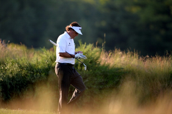 Phil Mickelson of the United States walks off the 14th green during Round Two of the 113th U.S. Open at Merion Golf Club on June 14, 2013 in Ardmore, Pennsylvania.  (Getty Images)