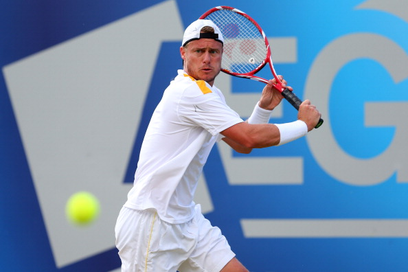 Lleyton Hewitt hits a backhand shot during the Men's Singles semifinal round match against Marin Cilic of Croatia at Queens Club on June 15, 2013 in London, England. He takes on Wawrinka in what is the pick of all the first round men's matches at Wimbledon this year. (Getty Images)