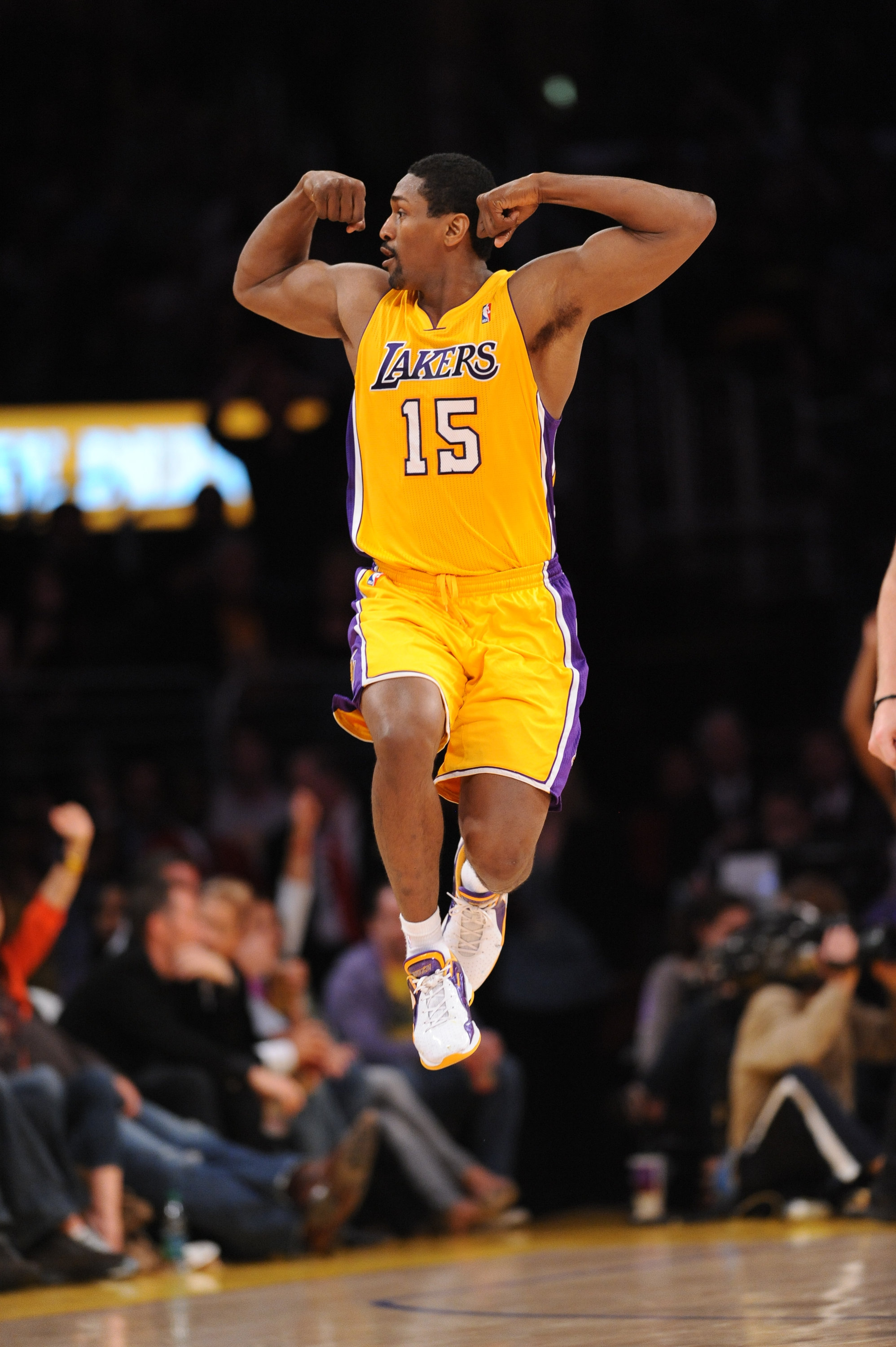 Ron Artest #15 of the Los Angeles Lakers jumps while flexing his muscles after dunking against the Los Angeles Clippers at Staples Center on March 25, 2011 in Los Angeles, California. (Getty Images)
