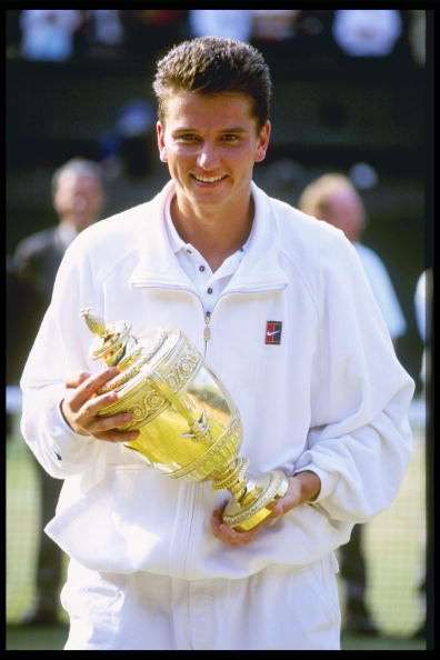 Richard Krajicek of the Netherlands holds the mens singles trophy after defeating Malivai Washington of the USA in straight sets in the mens final of the Wimbledon tennis championships at the all England Club in London, England in 1996. (Getty Images)