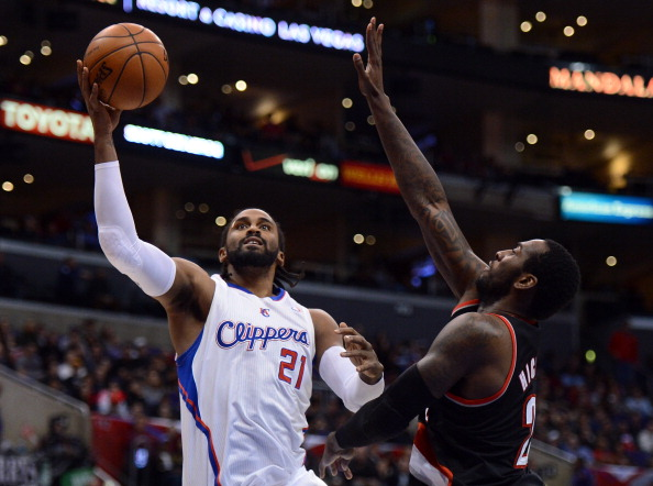 Ronny Turiaf #21 of the Los Angeles Clippers scores in front of J.J. Hickson #21 of the Portland Trail Blazers at Staples Center on January 27, 2013 in Los Angeles, California.  (Getty Images)