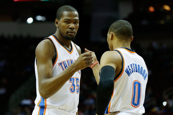Kevin Durant #35 and Russell Westbrook #0 of the Oklahoma City Thunder get ready for the game against the Houston Rockets at Toyota Center on February 20, 2013 in Houston, Texas. (Getty Images)