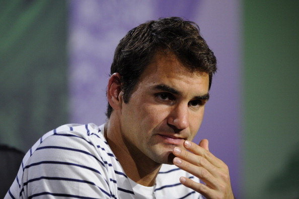 Roger Federer of Switzerland speaks to members of the media during a press conference on day three of the Wimbledon Lawn Tennis Championships at the All England Lawn Tennis and Croquet Club on June 26, 2013 in London, England.  (Photo by Thomas Lovelock/AELTC - Pool/Getty Images)