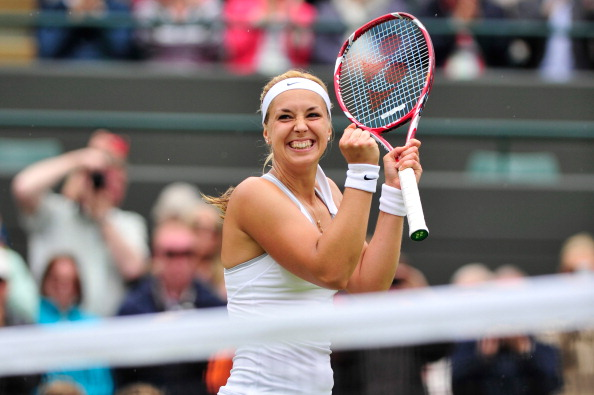 Germany's Sabine Lisicki celebrates beating Estonia's Kaia Kanepi during their women's singles quarter-final match on day eight of the 2013 Wimbledon Championships tennis tournament at the All England Club in Wimbledon, southwest London, on July 2, 2013. (Getty Images)