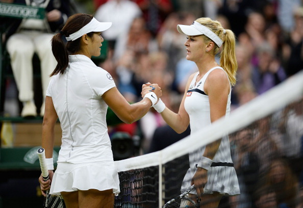 Agnieszka Radwanska of Poland shakes hands at the net with Na Li of China after their Ladies' Singles quarter-final match on day eight of the Wimbledon Lawn Tennis Championships at the All England Lawn Tennis and Croquet Club at Wimbledon on July 2, 2013 in London, England.  (Getty Images)