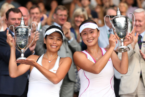 Shuai Peng (R) of China and Su-Wei Hsieh of Taipei smile as they pose with the Ladies' Doubles trophies after their Ladies' Doubles final match against Ashleigh Barty of Australia and Casey Dellacqua of Australia on day twelve of the Wimbledon Lawn Tennis Championships at the All England Lawn Tennis and Croquet Club on July 6, 2013 in London, England.  (Getty Images)
